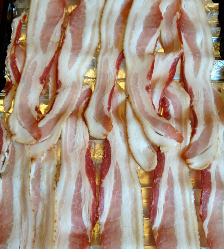 Bacon on a cookie sheet ready to go into the oven.