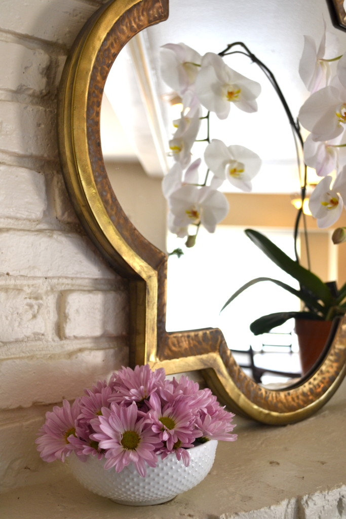 Mantel with mirror and orchid.