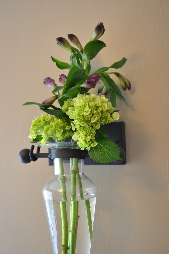 Glass wall vase with hydrangeas.