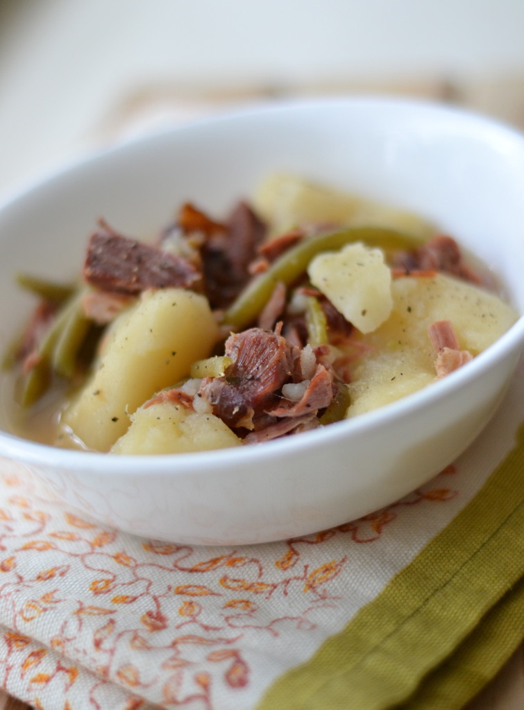 Slow cooked ham in a white bowl