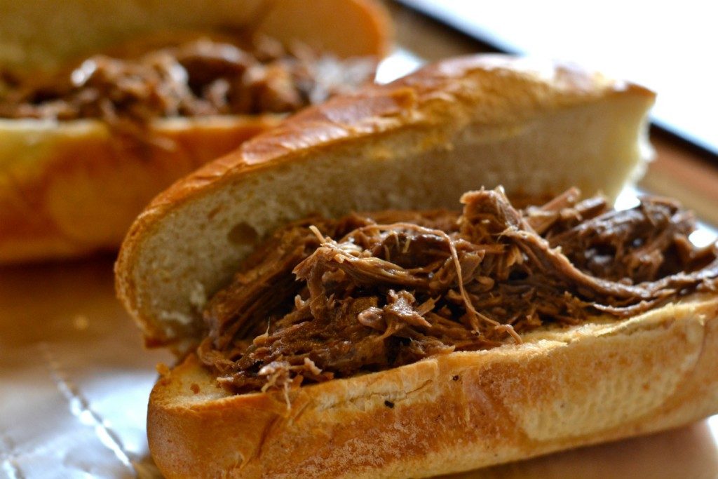 Delicious slow cooked rump roast in a French Dip sandwich