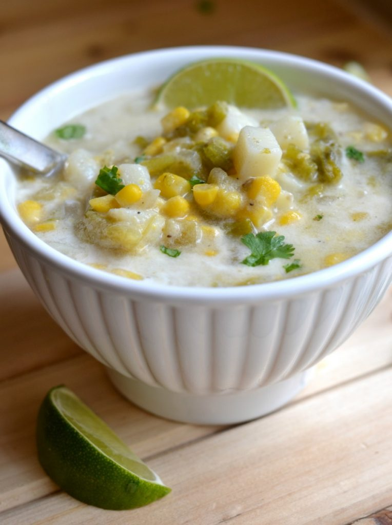 Corn and green chile chowder in a white bowl
