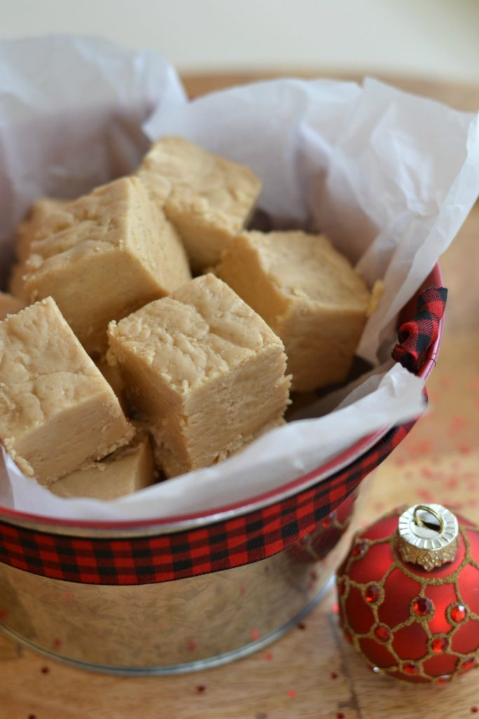 Delicious peanut butter fudge in a festive container. Ready to gift for Christmas!