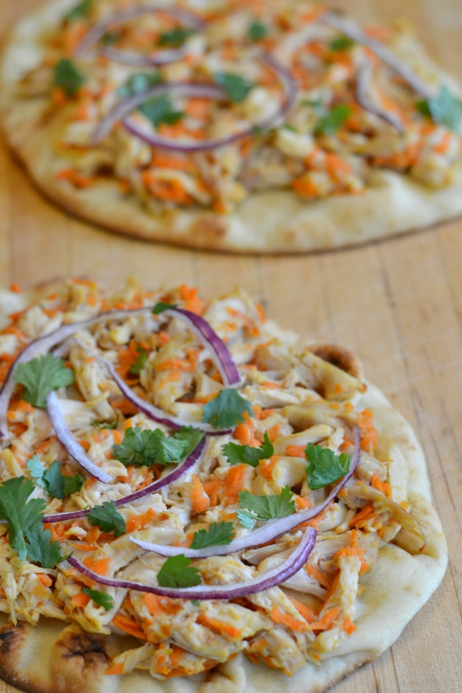 Easy Thai Chicken Flatbreads on a cutting board
