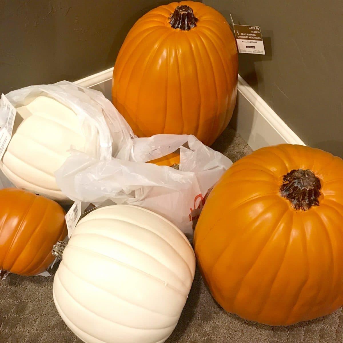 Assortment of white and orange craft pumpkins.