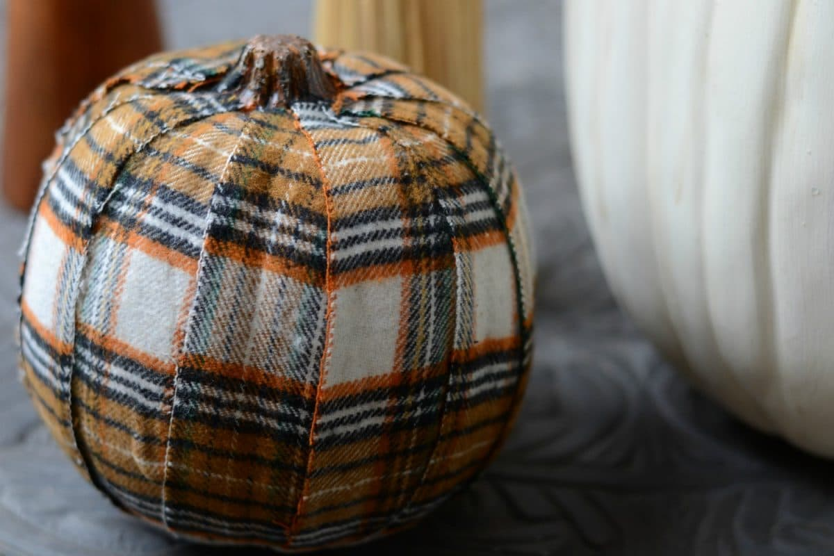 Craft pumpkin covered in plaid fabric.