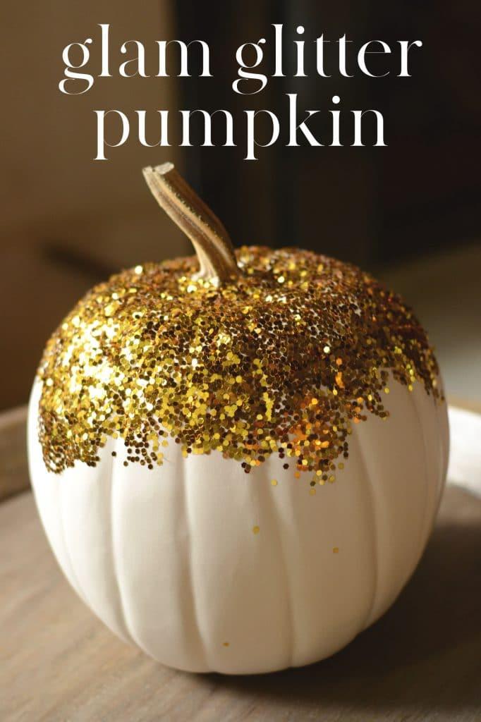 White craft pumpkin covered in gold glitter.
