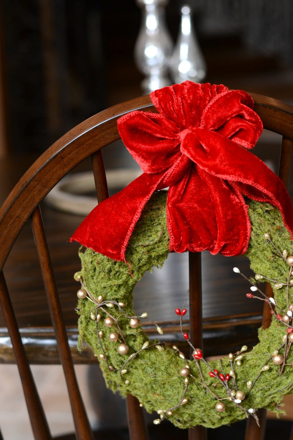Hang wreath over the back of a dining chair