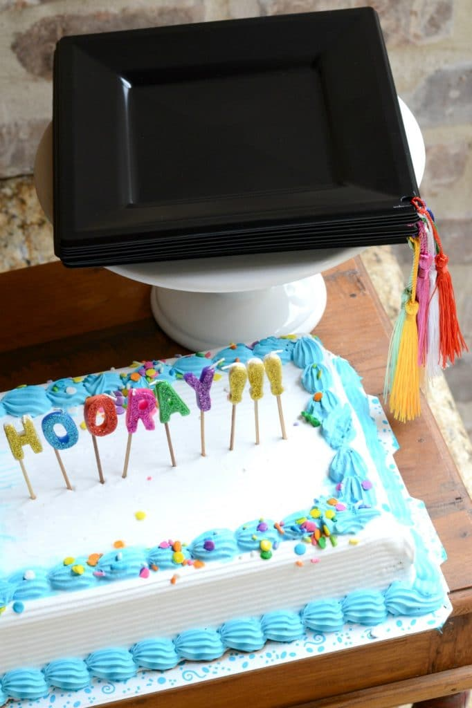 Graduation cake and plates made to look like graduation caps with tassels