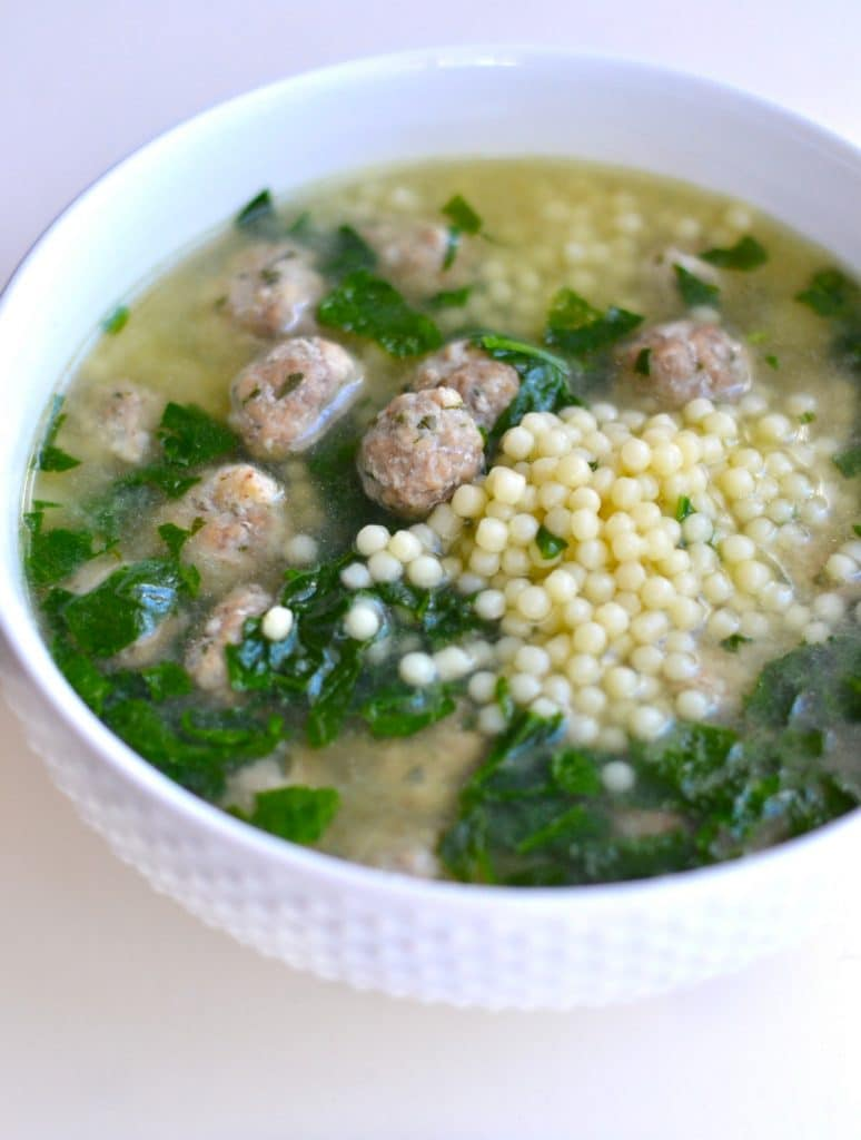 Tiny pasta balls and meatballs in Italian wedding soup