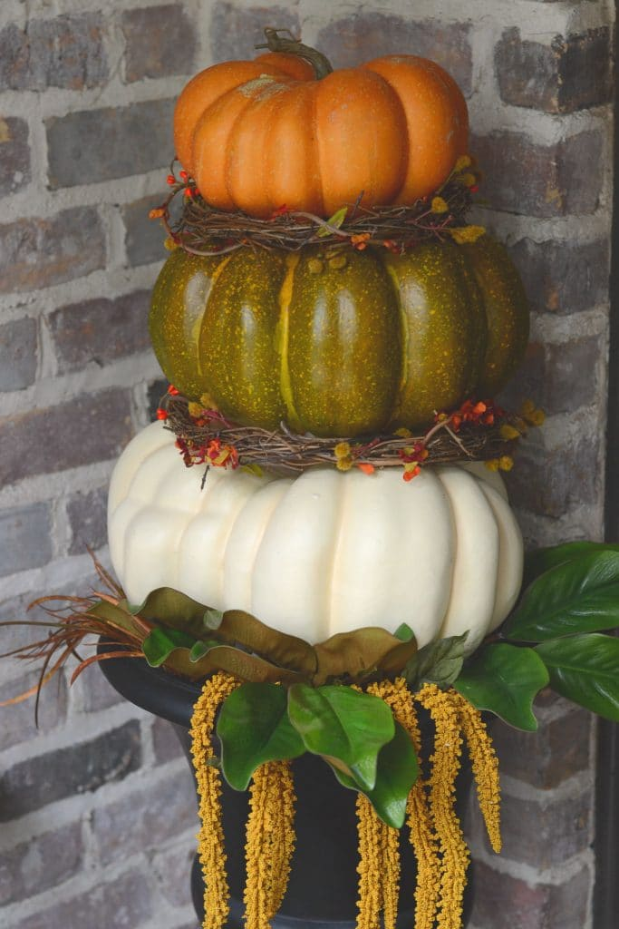 Pumpkin topiary in front of brick wall