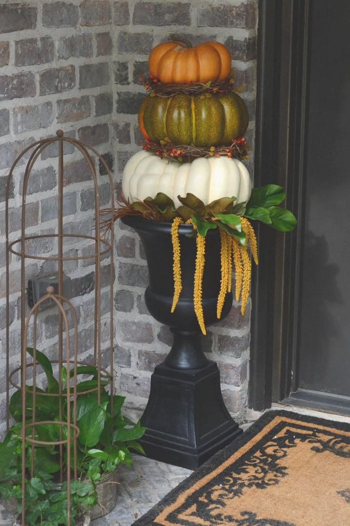 Front porch with pumpkin topiary