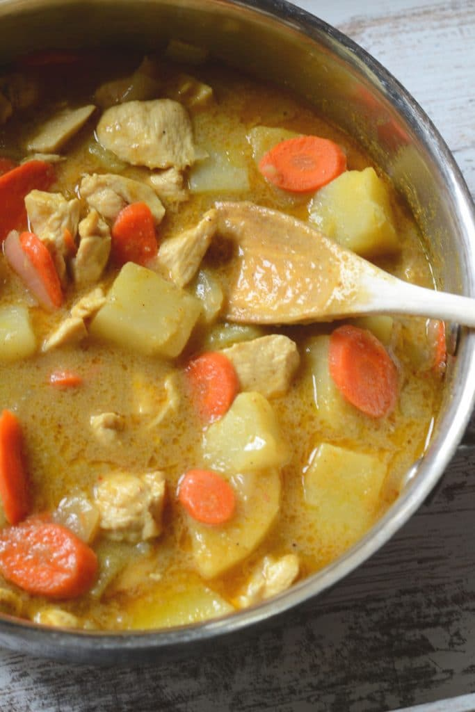 Thai curry simmering in a pan