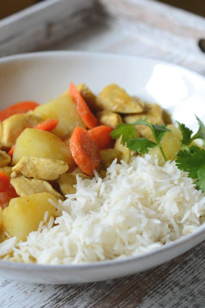 Homemade Thai curry served with jasmine rice and cilantro