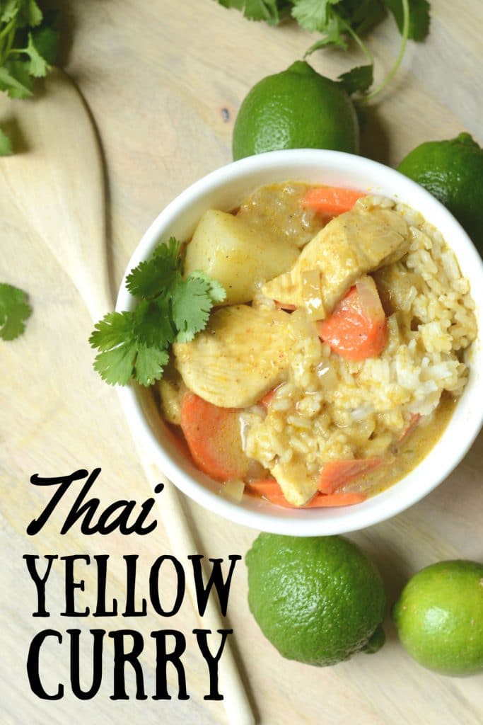 Thai Yellow Curry with cilantro and lime garnish.