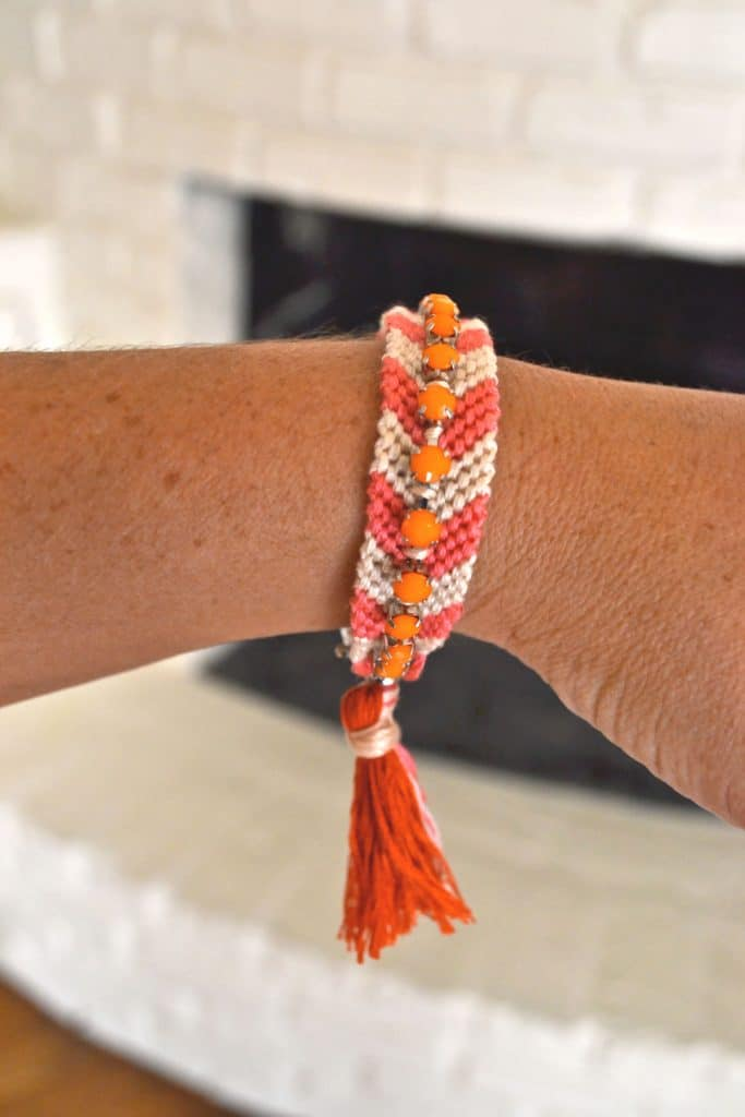 Finished friendship bracelet on a wrist.