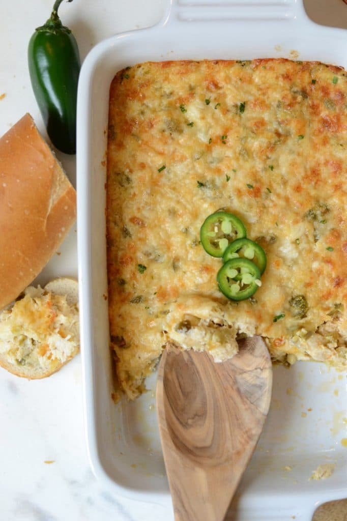 Baked crab dip served with sliced baguette