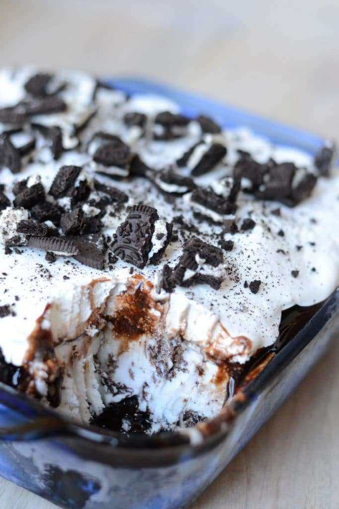 Ice cream cake topped with crushed Oreos.