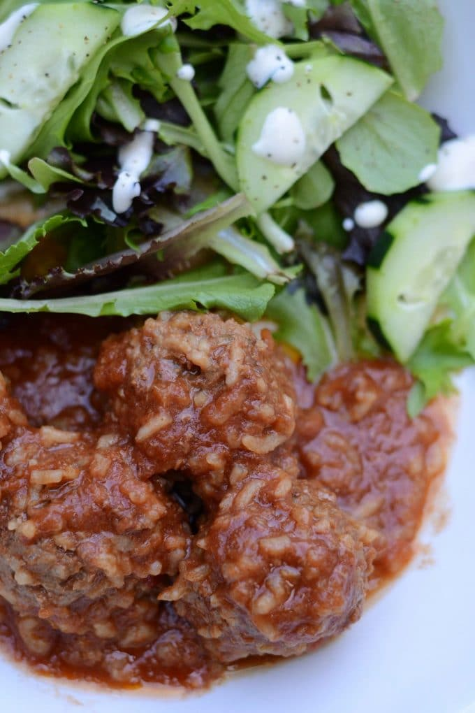 Porcupine meatballs on a plate with salad
